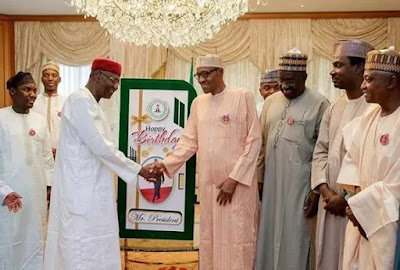 Photos: president Buhari Receives Cards From Granddaughter And Others As He Turns 75