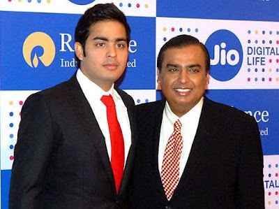 mukesh ambani with his son anant ambani