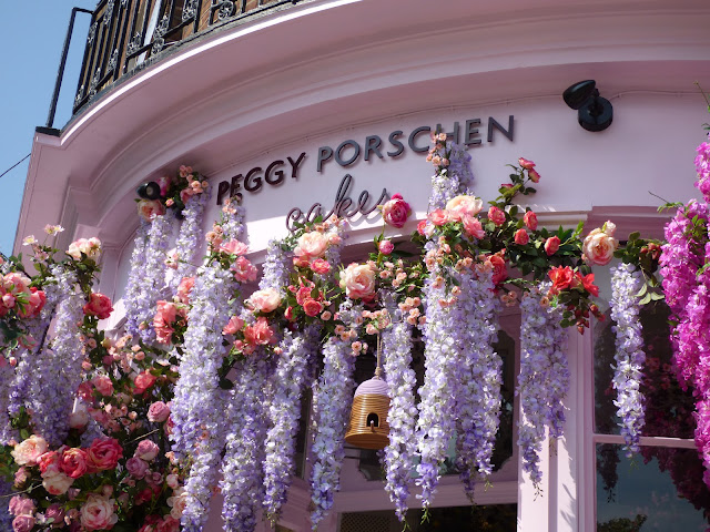 Flower arch and floral display outside Peggy Porschen cafe, London, for free flower festival Belgravia in Bloom 2018
