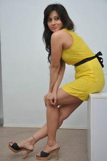 Actress Harshika Poonacha Stills in Yellow Short Dress at Appudala Ippudila Movie Promotions  0073.jpg