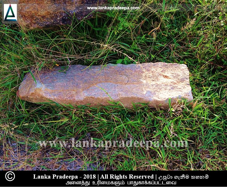 A broken stone pillar at Walathapitiya archaeological site