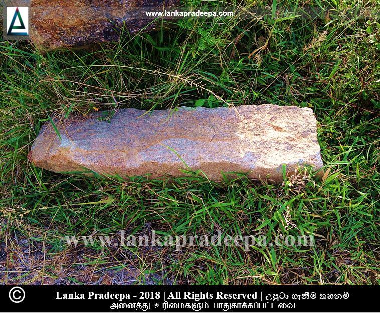A broken stone pillar