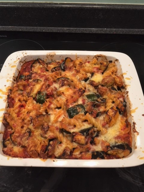 Cooked Mediterranean Vegetable pasta bake in a white casserole dish