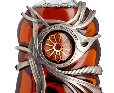 behind the bottle's cabochon is an ethereal silver replica of the beautiful rose window inside the Cathedral