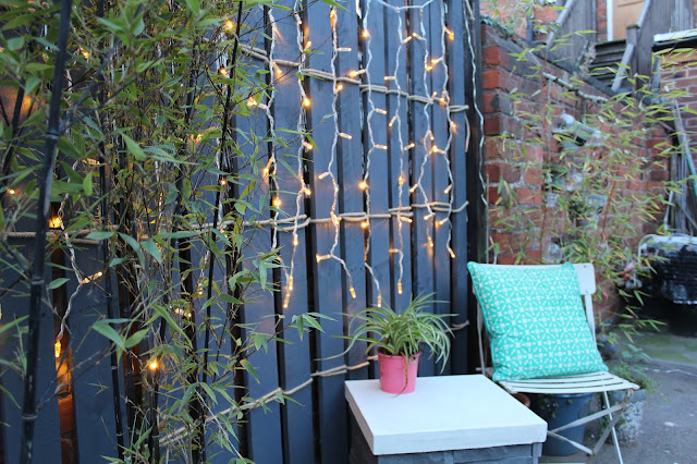 cute little corner of the garden with feature pallets