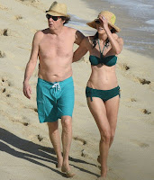 In an aqua trunks, Paul McCartney, 73, accompanied his beautiful 5 years lover, Nancy Shevell, 56, for walking in a green bikini as The couple seemed very enjoy the St Barts situation of beach on Sunday afternoon, December 27, 2015.