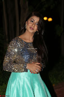Nikki Galrani in Green Skirt  Top at Marakathamani music launch ~  Exclusive (72).JPG