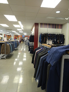 clean and bright shop floor with suits