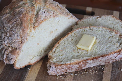 Sliced Irish soda bread with butter.