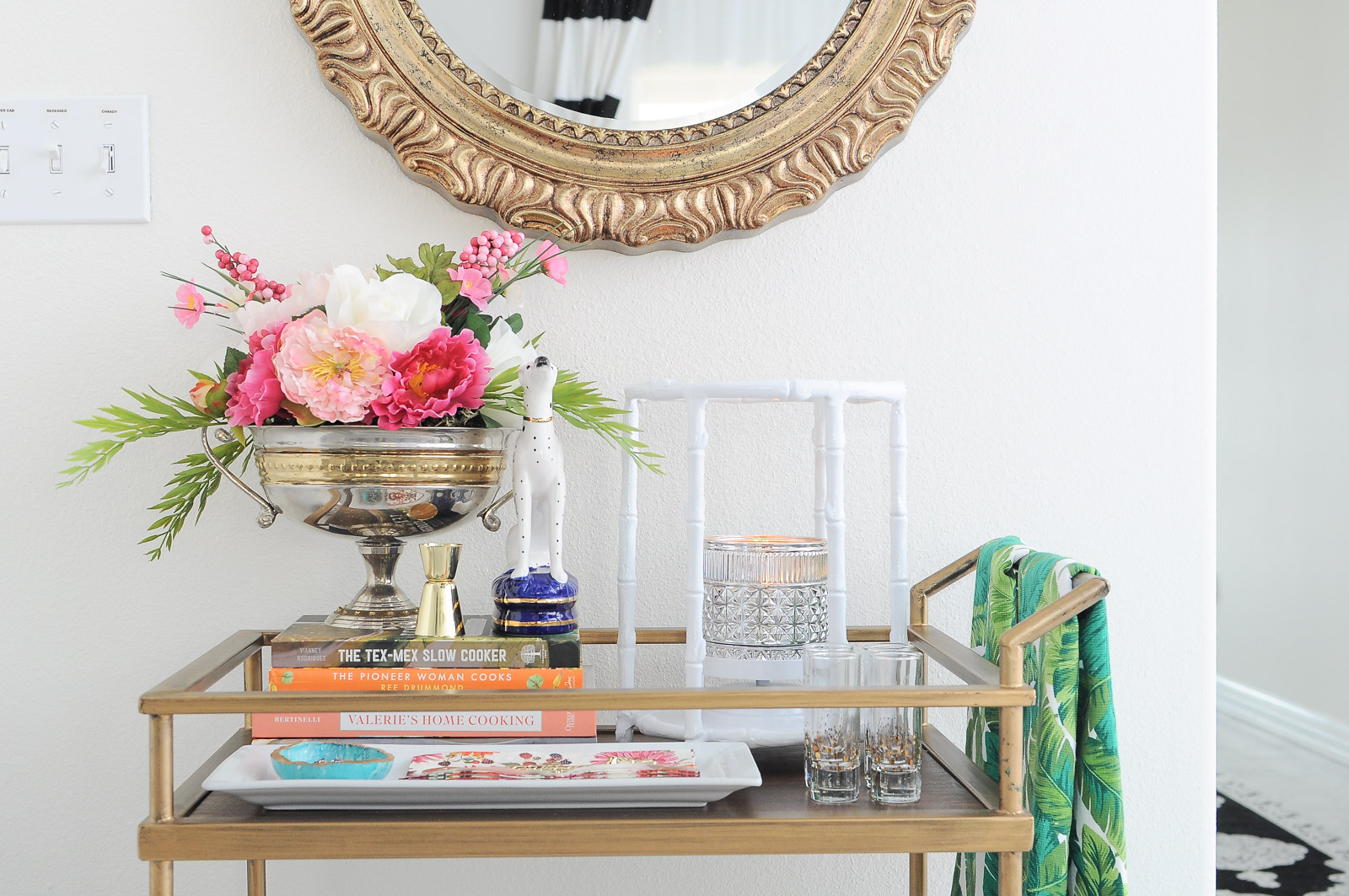 A gold bar cart gets a chic and stylish upgrade with spring decor essentials.