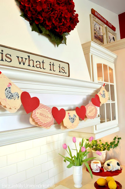 Pretty note cards to make a Valentine's Day banner or garland hanging on a kitchen hood