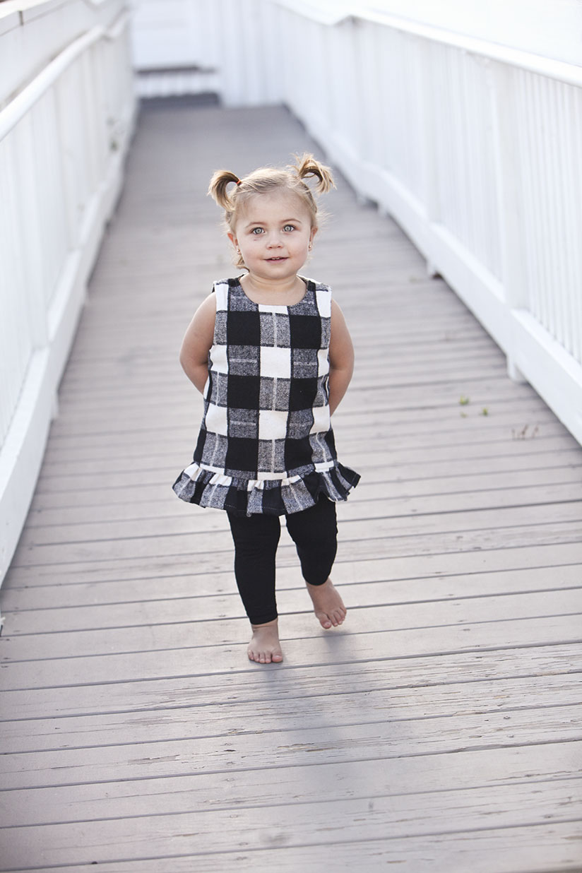 Little girl in gingham tunic