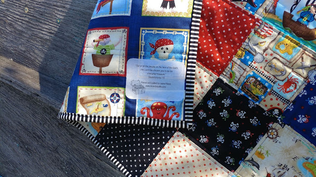 Label with Bible verse on pirate baby quilt