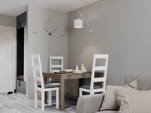 This particular design calls further attention to the choice of grey walls with a large wall clock design element that actually uses the wall itself as the face of the clock.