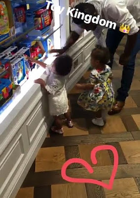 Photos: Mikel Obi takes his twin daughters toy shopping in their 1st birthday today