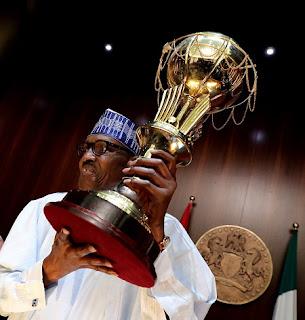 Muhammadu Buhari Lifts FIBA Cup In Aso Rock