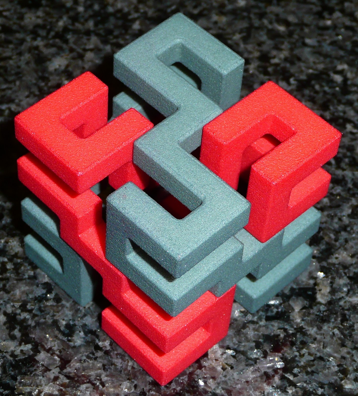 PuzzleMad: Superstrings from Microcubology