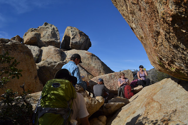 jumble of rocks below two towering ones