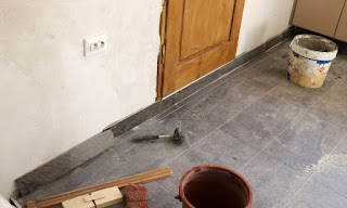 The very last edging tile is fitted in the kitchen