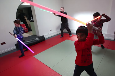 The Academy teaches children and adults martial arts with the use of lightsabers