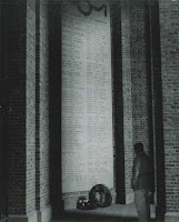 A black and white photograph of a man looking at the Memorial.