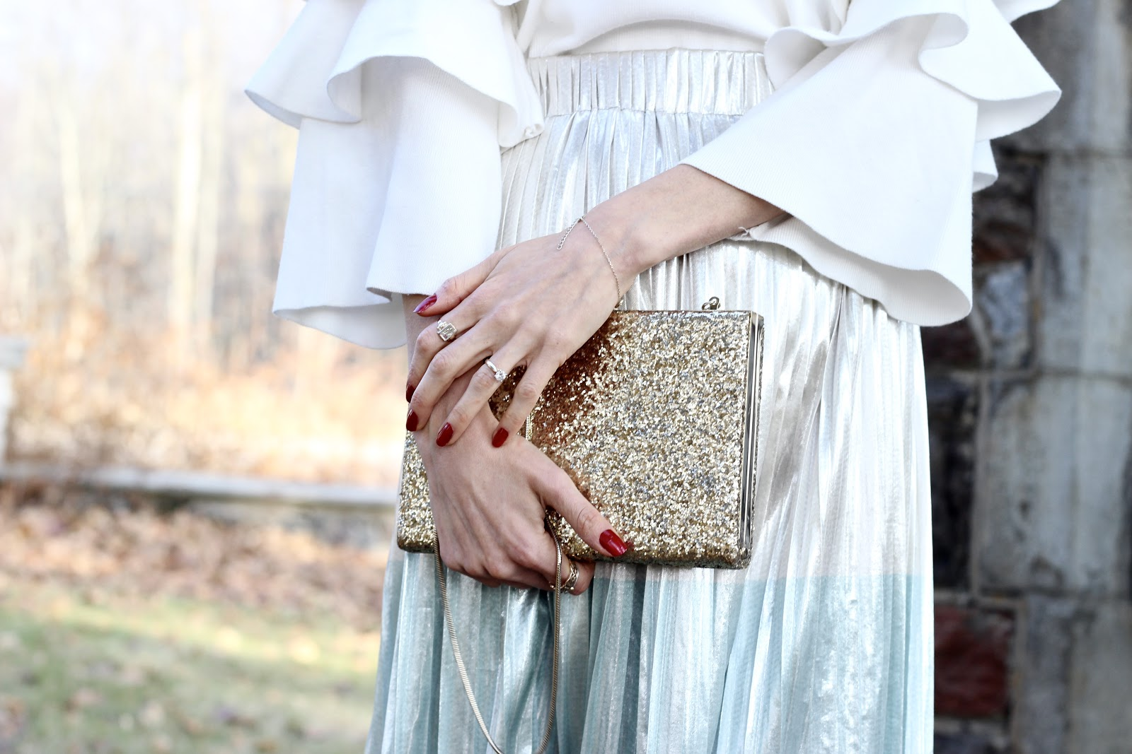Holiday glam-- Zara pleated midi color block gold, silver, blue, White tier sleeve sweater Chicwish, Nine West pumps, Kate spade gold sequin clutch, white and gold earrings