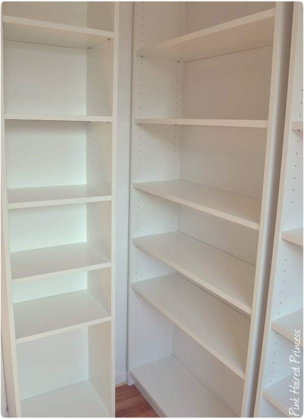 white Ikea Billy bookcase shelves in shoe room