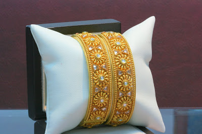 Broad Gold Bangles Jewellery Designs