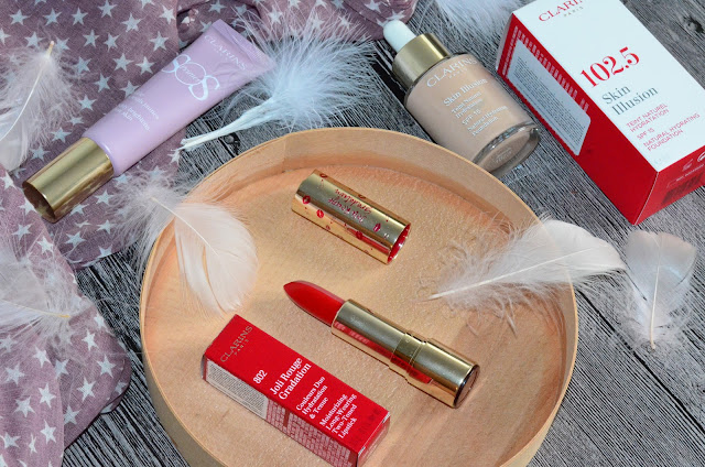 Новинки Clarins: SOS Primer 05,   Skin Illusion Foundation SPF 15,  Joli Rouge Gradation 802 red gradation помада-градиент
