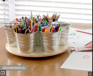 use a lazy susan to store community classroom supplies