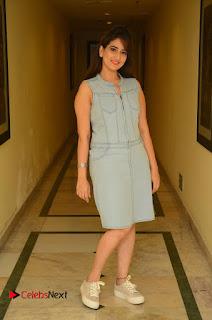 Actress Manjusha Pictures in Short Dress at Dora Movie Audio Launch  0086.JPG