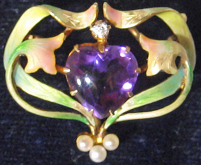 Art Nouveau brooch with amethyst, enamel, and pearls.