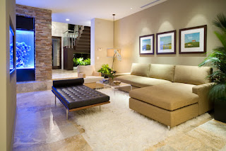 Wonderful View of the Sitting Space with Brown Modern Sofa Bed and Dark Bench near Glass Table