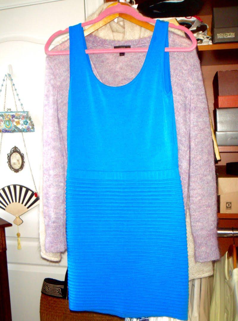 Blue sleeveless dress hanging up.