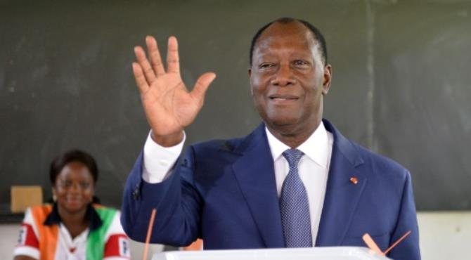 Ivory Coast's President Alassane Ouattara (R) says the revised constitution could end years of stability. By Sia Kambou