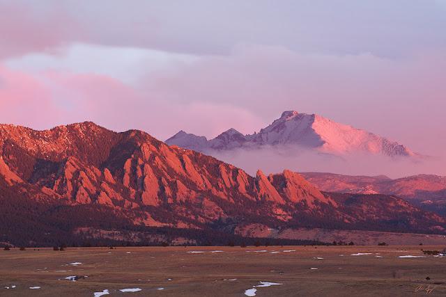 The Boulder Flatirons and Longs Peak at sunrise alpenglow in the Colorado Front Range