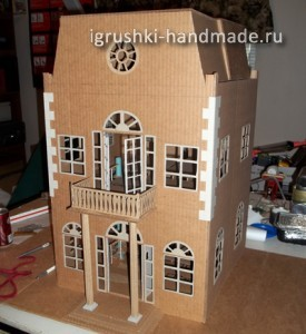 Modern style dollhouse made of a cardboard