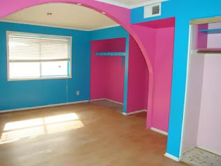 An image of pink and blue painted house