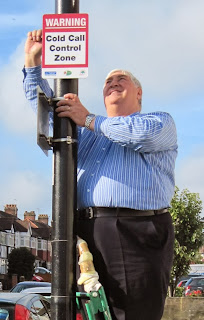 Councillor Eric Allen putting up a sign
