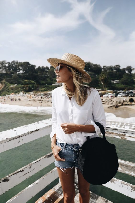 Lady in White Color Blouse with Brown Color Round Hat