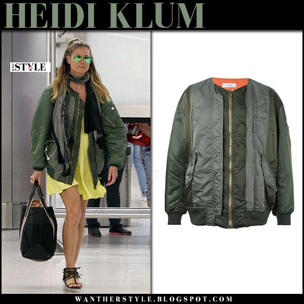 Heidi Klum in green satin bomber jacket facetasm, yellow mini dress and black fringe sandals what she wore