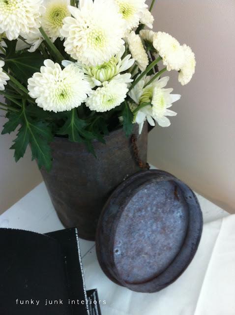 rusty metal junk flower vase