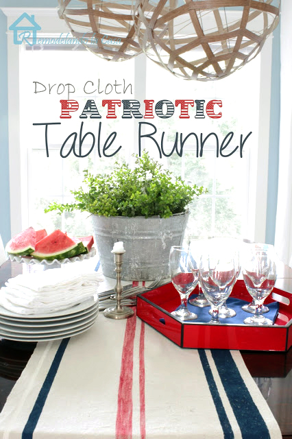 dining table set for fourth of july with runner, metal bucket, watermelon, red tray