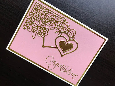 Hand made wedding card with gold die cut corner and sentiment on pink background