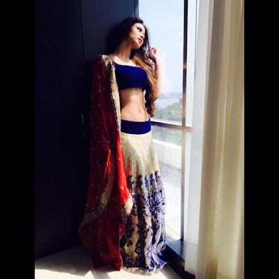 Popular Indian Model And TV Actress Mouni Roy Looking Gorgeous In Blue Color Indian Lehenga.