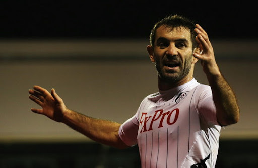 Fulham midfielder Giorgos Karagounis reacts after scoring his side's equaliser against Blackpool