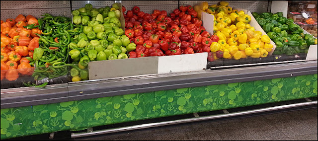 Supermarket display stand full of fresh peppers