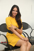Actress Poojitha Stills in Yellow Short Dress at Darshakudu Movie Teaser Launch .COM 0286.JPG