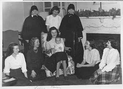 students and Sisters with a baby in the Practice House Living Room, c. 1940s