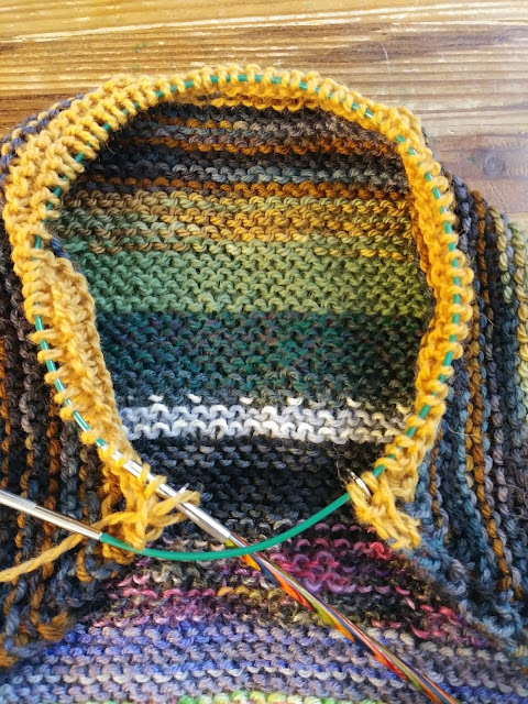 knitting a diagonal striped blanket with scrap sock yarns